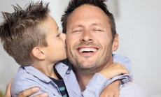 Son kissing daddy