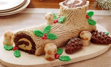 BUCHE DE NOELFood NetworkEggs, Sugar, Unsalted Butter, Instant Espresso, Rum, Chocolate Genoise Sheet, Almond Paste,Confectioners' Sugar, Light Corn Syrup, Egg Yolks, Salt, Cake Flour, Cornstarch, AlkalizedCocoa