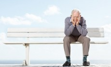Depressed old man sitting on the bench - Outdoor