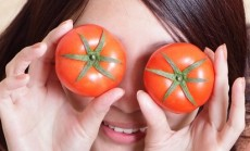 Tomato. funny girl showing tomatos